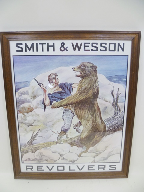 A FRAMED SHOP DISPLAY POSTER - SMITH & WESSON REVOLVERS, with fighting bear, 55 x 44cm