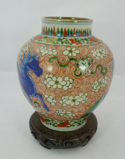 AN 18TH/19TH CENTURY CHINESE ORIENTAL OVOID PORCELAIN VASE decorated with blue Kylin, cacti and white flowers and scrolls in reds and greens, 19cm high