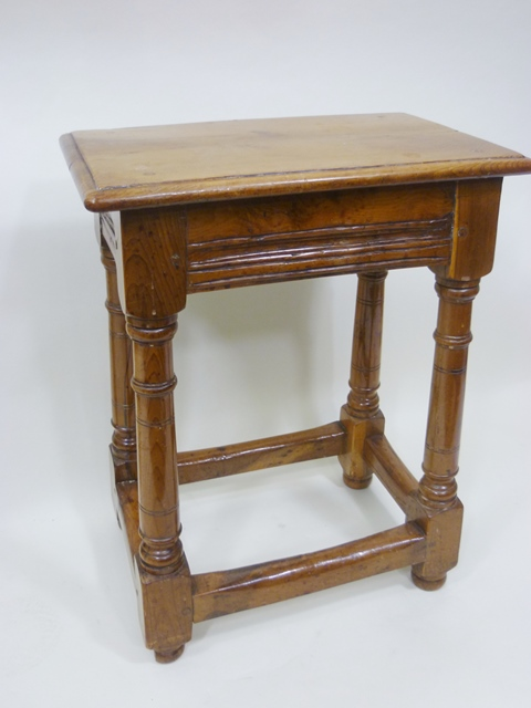 A 19TH CENTURY YEW WOOD JOINT STOOL, of typical form and construction, with plain rectangular top, over four cannon barrel turned and block legs united by box stretchers, 57cm x 44cm