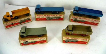 A SELECTION OF FIVE DINKY SUPERTOYS brown boxed models, no.503 Foden Flat Truck with tailboard, Guy 4 ton Lorry no.511, Guy Flat Truck no.513, Bedford Lorry no.521, Foden 8 wheel wagon no.501