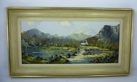 CHARLES WYATT WARREN A whitewashed cottage in a barren Snowdonia landscape, with river rapids over a causeway in the foreground. Pallet knife on hardboard. 26 x 54cm in white finished frame