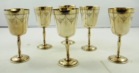 CHARLES S. GREEN & CO. A SET OF SIX SILVER GOBLETS, each having an inverted bell bowl with garland engraved decoration turned stem and circular foot, Birmingham 1969, 126g. each (756g. total)