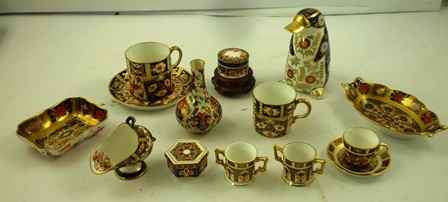 A SELECTION OF ROYAL CROWN DERBY of mixed vintages to include coffee can, two miniature mugs, one cup and saucer, miniature sugar scuttle, oval dish, covered box and a modern mole/platypus