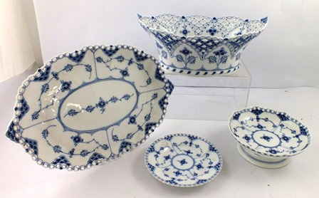 A ROYAL COPENHAGEN PORCELAIN PART SUITE OF FOUR ITEMS, each decorated in underglaze blue and white with pierced decoration, oval fruit bowl, 12cm high x 30cm wide, and dish, 33cm x 22cm, an elevated bowl, 5.5cm high x 16cm wide, and tea plate, 15cm diameter