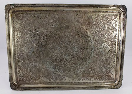 AN EARLY 20TH CENTURY ASIAN SILVER COLOURED METAL VANITY TRAY having tooled corners and engraved ornamental centre, 27cm x 37.5cm, 957g