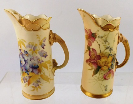 TWO VICTORIAN ROYAL WORCESTER PORCELAIN JUGS each of 1229 pattern, blush ivory highlighted with gilt and polychrome flora, Rd.No.74149, date codes 1893 and 1894, 15.5cm high