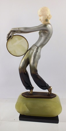 JOSEF LORENZL Tambourine Dancer A cast bronze patinated and painted figure of an Art Deco girl with instrument, circa 1925, on onyx plinth, signed, 27cm high