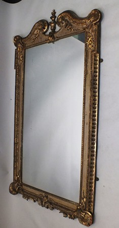 AN EARLY 19TH CENTURY CARVED AND GESSO MIRROR having double scroll swan neck top, cast leaf and scroll surround, with plain rectangular plate, 183 x 100cm