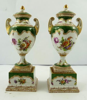 A PAIR OF 20TH CENTURY DRESDEN PORCELAIN ORNAMENTAL VASES each lidded twin handled on square plinths decorated with green fish scale and Deutsch Blumen 34cm