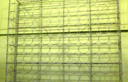 A LARGE FRENCH WINE RACK of hop dip galvanised wired contruction, to hold 144 bottles of wine