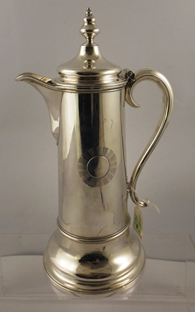 BARNARD FAMILY A SILVER FLAGON having hinged lid with finial, tapered and ringed body and scroll handle, London 1874, 923g, 34cm high