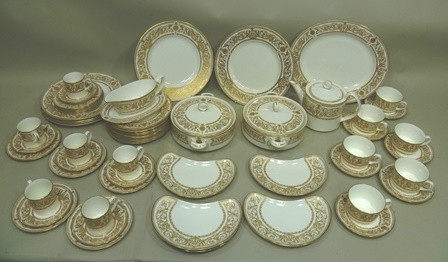 A ROYAL WORCESTER HYDE PARK PATTERN BONE CHINA TEA, COFFEE AND DINNER SERVICE comprising; a pair of circular lidded tureens, a teapot with cover, a gravy boat with stand, a 33cm serving dish, five demi-lune salad/side plates, 6 x 27cm dinner plates, 10 x 20cm dessert plates, 10 x 15.5cm tea plates, 6 x tea saucers, 6 x coffee saucers, 6 x coffee cans