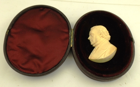 A VICTORIAN CASED IVORY PORTRAIT PROFILE OF JOHN BRIGHT (1811-1889) Quaker, British Radical, and Liberal Statesman, Birmingham MP 1858-89 signed W. Hogh (Wilhelm Hogh, b.1846). The ivory 6.5cm in an oval morocco leather, silk and velvet lined casewith JB monogram, case, 12cm x 9.5cm