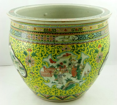 A LATE 19TH/EARLY 20TH CENTURY CHINESE EXPORT PORCELAIN FISH BOWL the exterior decorated in polychrome with panels of ennobled figures against a yellow ground, with stylised motifs, 35cm high x 41.5cm diameter