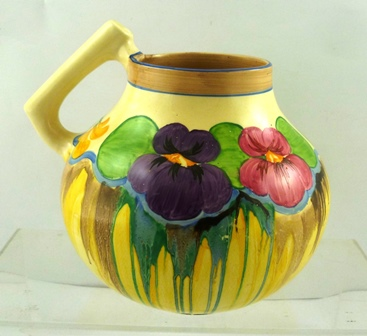 CLARICE CLIFF A 1930S BALUSTER CARAFE having angular handle and decorated in Pansies pattern, shape 684, 20cm high